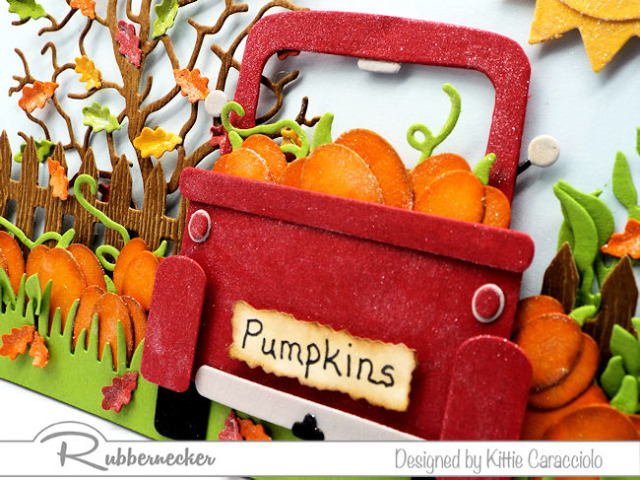 All the adorable fall themed details on today's version of red truck cards were made with new dies from Kittiekraft by Rubbernecker