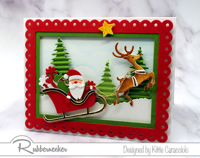 All of the darling details on this santa claus card were made with dies from Kittiekraft by Rubbernecker