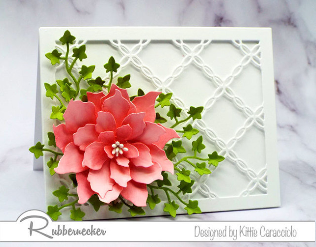 a handmade greeting card featuring a detailed lattice die as a base for a die cut flower all made with card making dies from Rubbernecker