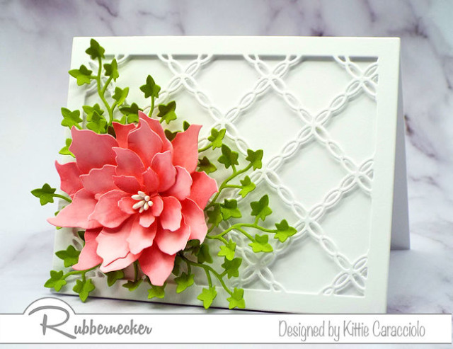 a detailed lattice die used on a DIY greeting card with a large die cut flower all made using card making dies from Rubbernecker