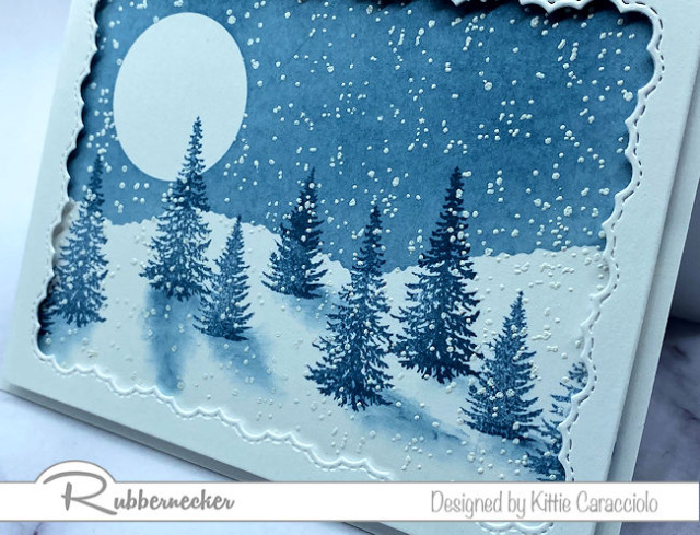 a beautiful hand stamped winter pine tree card with trees in moonlit snow all made using new stamps from Rubbernecker