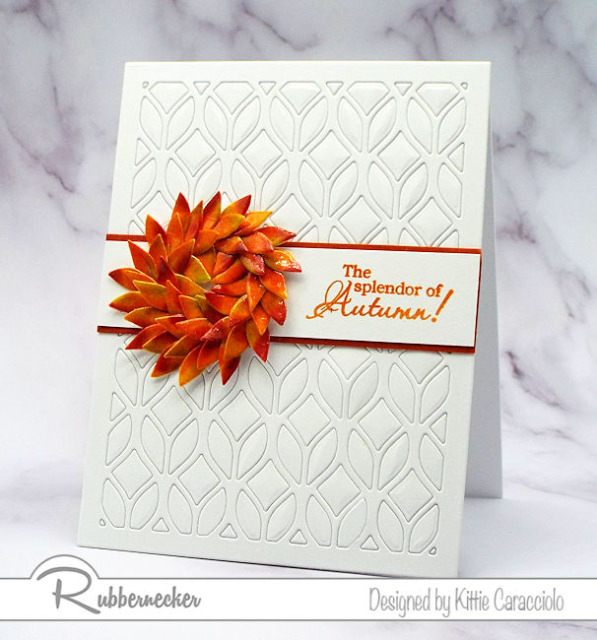 a handmade card showing a way to use cover plate dies to create a textural background AND a focal element